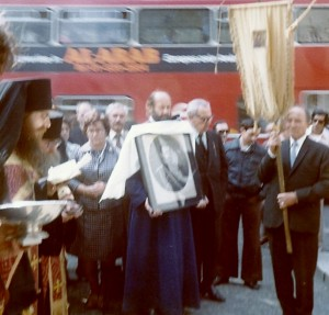 In this photograph Prince Dmitri Galitzine (at that time a Reader) holds a portrait of the Tsar-Martyr at a panikhida served before the Cenotaph in Whitehall, London, July 1978. Others in the photograph (from l. to r.): Archimandrite Alexis, Choir Director Antonina Vladimirovna Ananina and Starosta Count Wladimir Petrovich Kleinmichel.